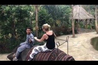 Sally at the elephant orphanage in Lombok while on a break from her drug rehabilitation treatment.