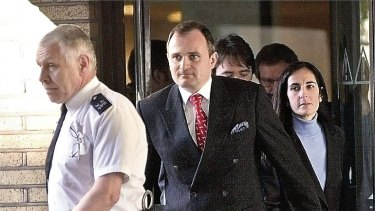 British Army major Charles Ingram and his wife Diana leave Southwark Crown Court in London, April 7, 2003.