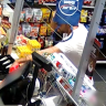 Thief uses shopping bag to hide his face, steal cigarettes