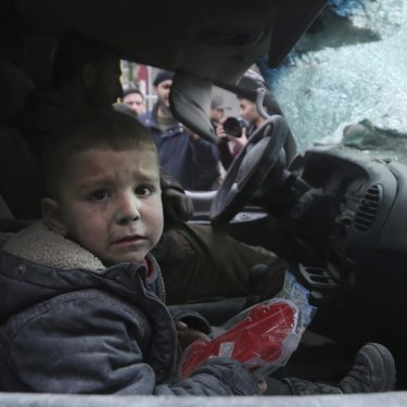 A boy in a damaged car after government air strikes in the town of Ariha, in Idlib province last month.