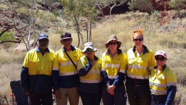Dr Huntley (second from right) with the research team (left to right) Peter Flann, Maurice Narrier, Tanya Goody, Annabelle Davis and Lynley Wallis, at the rock art site.