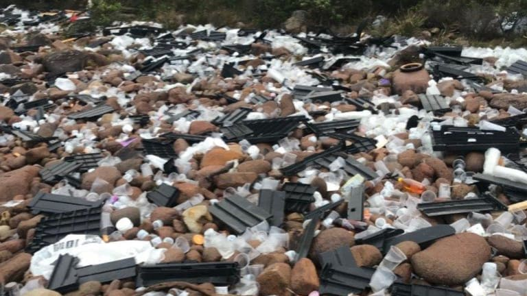 Some of the debris washed up on rocks at Jimmys Beach near Port Stephens.
