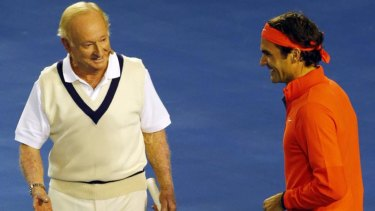 Australian tennis legend Rod Laver enjoys a bit of banter with Swiss champion Roger Federer at Rod Laver Arena during a charity event in Melbourne.