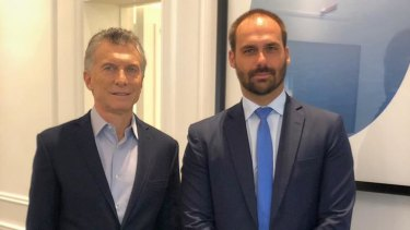 Brazilian congressman Eduardo Bolsonaro, right, meets with Argentina's President Mauricio Macri in May. Eduardo is one of President Jair Bolsonaro's three sons.