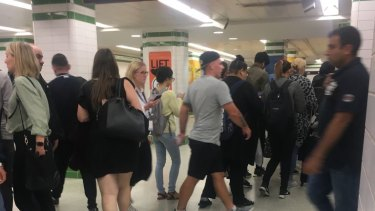 Commuters spill out onto the concourse below the platforms at Central station as trains stop on Friday night.