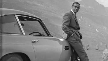 Connery poses with Bond's famous Aston Martin.