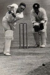 Fetch that:  Alan Davidson unleashes a cover drive.
