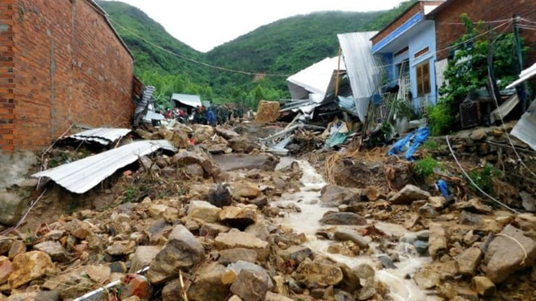 At 13 have died and others are missing in landslides triggered by heavy rain in southern Vietman.