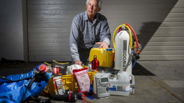 Ric Hingee with some equipment he has ready in case of fire at his home in Duffy.