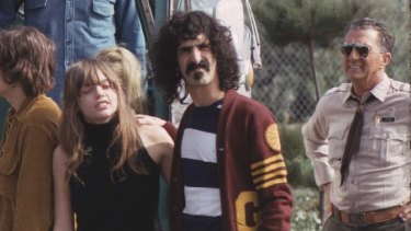 Frank Zappa with Gail Zappa and The Mothers of Invention on the road.