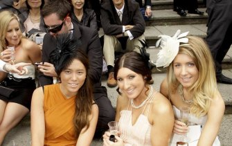 Punters enjoy the atmosphere in the crowd on Melbourne Cup Day. No social distancing.