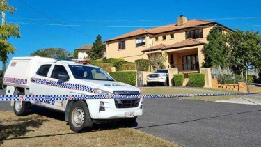 Police at Toutai Kefu's Coorparoo home on Monday morning.