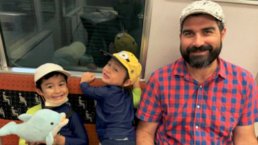Matt Gale with his two boys, Jun and Ren, on their way to Universal Studios in Osaka, Japan.