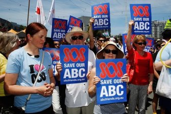 Hundreds of protesters gathered in Melbourne's Federation Square to rally against federal government cuts to the ABC budget in 2018.