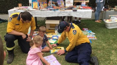 Firefighters chat to children who ran a stall to raise money for the RFS.