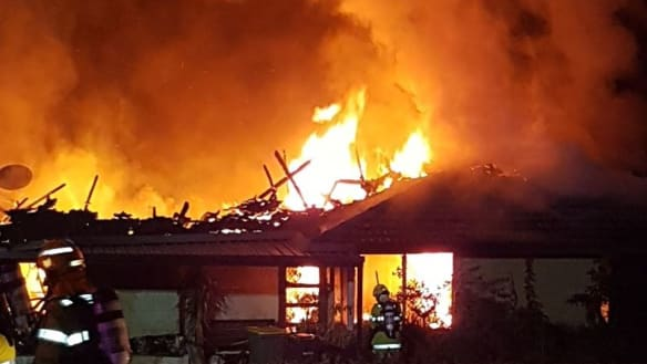 Neighbour fined after father saves two children from fire