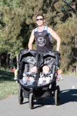 Canberra dad Luke Greenhalgh training with the twins Dahli and India.