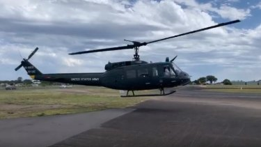 The helicopter is a Bell uh-1/B205 owned by Brisbane Helicopters.