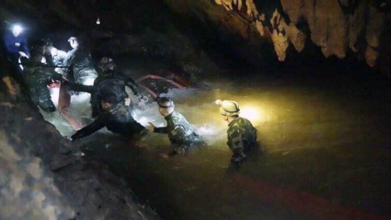 Thai rescue teams search inside cave complex.
