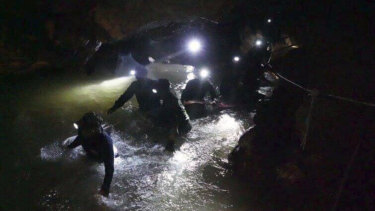 Thai rescue teams work to save the 12 boys and their coach from the Tham Luang cave complex.