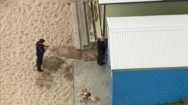 Police say the explosives equipment was found near one of the beach's bathing boxes.