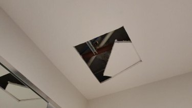 A hole cut in the ceiling of an apartment in Australia 108 as Multiplex investigates the source of cracking and creaking noises in the tower.