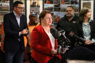 Premier Daniel Andrews, former Essendon great Michael Long (in the Raw jacket) and former Aboriginal affairs minister Natalie Hutchins (centre).