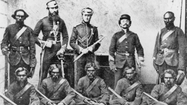 Members of the NMP photographed on 1 December 1864 at Rockhampton. In the back row from left to right are Trooper Carbine, George Murray, an unknown 2nd Lieutenant, an unknown Camp Sergeant and Corporal Michael. In the front row from left to right are Troopers Barney, Hector, Goondallie, Ballantyne and Patrick.