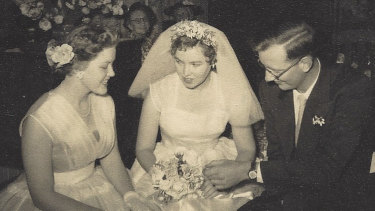 Shirley Stackhouse (centre) on her wedding day with bridesmaid and sister Judith Hobbs (nee Howes) and husband John.