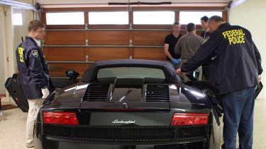 Federal police seized a Lamborghini and other luxury cars after Michael Issakidis was charged.