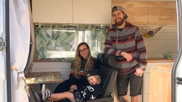 Jesse and Samantha Jeffrey and their son Bodhi in the converted campervan they share.