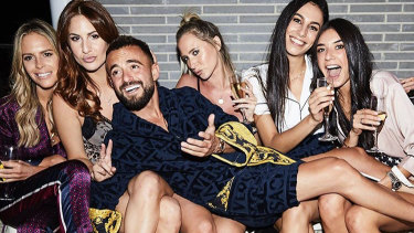 Birthday boy Gavin Rubinstein shares his Versace robe with guests.