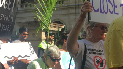'Close the torture camps': Hundreds march in Palm Sunday rally