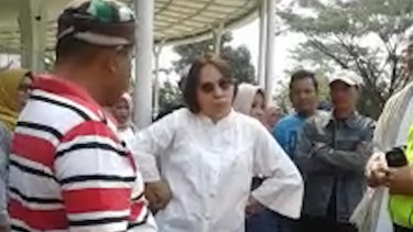 A 52-year-old Indonesian woman, known only as SM, who is facing charges of blasphemy after entering the holy area of the Jam Al Munawaroh mosque.