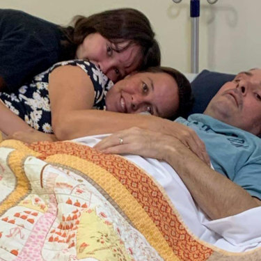 A quick decline: Brian McLoed with his family at the Canossa Palliative Care at Oxley.