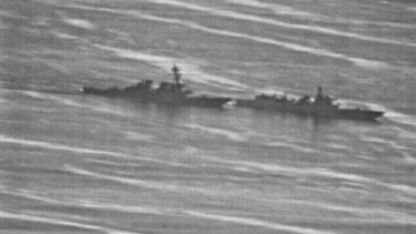 US Navy photo showing a confrontation between the USS Decatur (left) and PRC Warship 170 (right) in the South China Sea on Sunday.