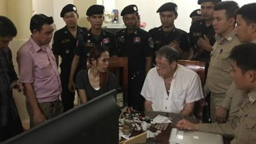 Gary Knowles at his arrest. Cambodian papers said the woman was his girlfriend.