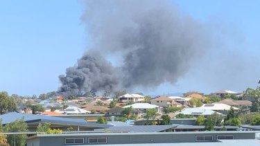 The two-storey house in Mango Hill goes up in flames.