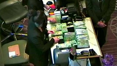 The NSW government inquiry has examined footage leaked to MP Andrew Wilkie showing large amounts of cash being exchanged in one of Crown Melbourne's private gaming rooms.