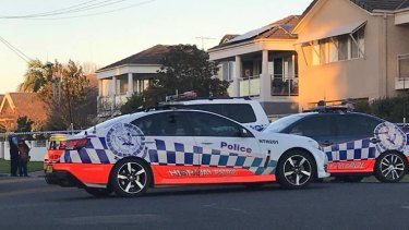 Police at a Newcastle house after the body of an elderly woman was found.
