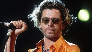 There was a huge gap between the on-stage Hutchence and the real man, says Lowenstein.