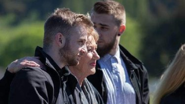 Ian Pullen's sons Cody and Troy carry their father's ashes, with Mr Pullen's mother Gill.