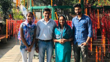 Australian permanent resident Pragya Chandel (second from left), his wife and two adult children were knocked back from the first repatriation flight out of Delhi after three of the four family members tested positive.