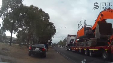 A large truck drives past in the minutes after the boys were on the road.