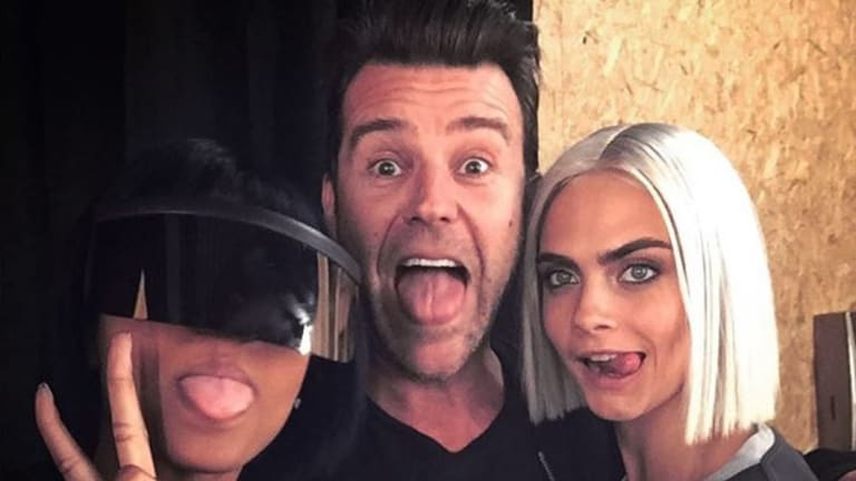 Paul Solomons with photographer Renell Medrano (L) and model Cara Delevingne (R).