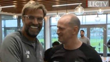 Reds zone: Maguire meets Liverpool manager Jurgen Klopp.