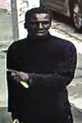 One of the men police wish to speak to following aggravated burglaries in a Spencer Street apartment complex.