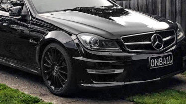 The Mercedes with the personalised registration plates.