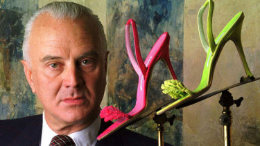 Manolo Blahnik poses with his trademark stilettos.