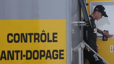 Chris Froome of Britain leaves an anti-doping truck.